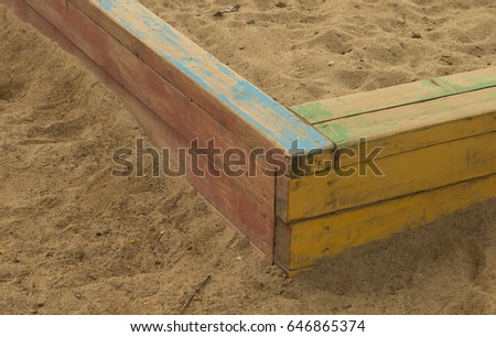 Wooden sandbox on the children's playground