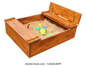Wooden children's sandbox with toys. Isolated on white background
