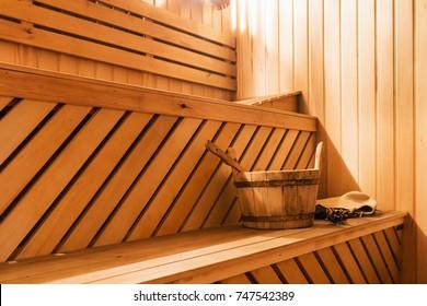 wooden sauna cabin with sauna accessories