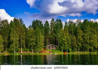 Wooden sauna log cabin at the lake in summer in rural Finland