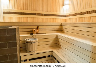 Wooden sauna with stone oven