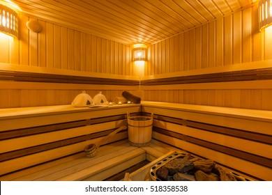 Wooden sauna with traditional sauna accessories