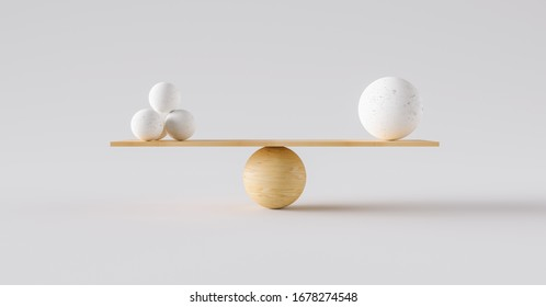 wooden scale balancing one big ball and four small ones. Concept of harmony and balance