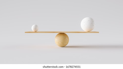 wooden scale balancing one big ball and one small ball. Concept of harmony and balance