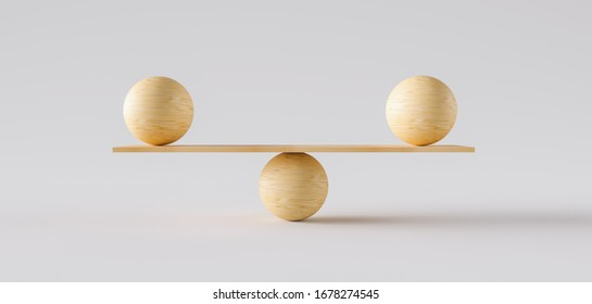 wooden scale balancing two big wodden balls. Concept of harmony and balance
