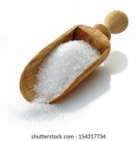 wooden scoop with white sugar