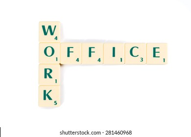 Wooden Scrabble Letter Tiles for Conceptual Work and Office Crossword, Isolated on White Background.