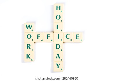 Wooden Scrabble Letter Tiles Forming Work, Office and Holiday Crosswords, Isolated on White Background.