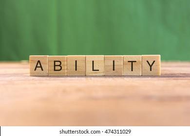 Wooden scrabble letters word ABILITY