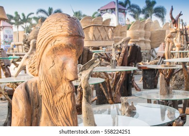 Wooden sculpture, face of world famous poet Rabindranath Tagore, tables with glass on top, handicrafts on display during the Handicraft Fair in Kolkata , earlier Calcutta, West Bengal, India.