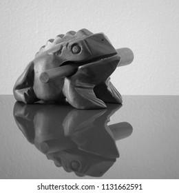 Wooden sculpture of frog. Mass production souvenir.