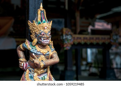 The wooden sculpture of a guardian carved in traditional balinese style, Bali, Indonesia