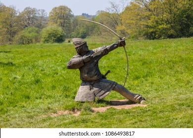 A wooden sculpture of a Norman Archer, located on the Battle of Hastings battlefield at Battle Abbey in the town of Battle, Sussex.