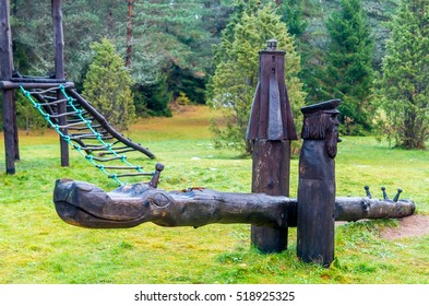 Wooden Sculptured Swing at Green Meadow
