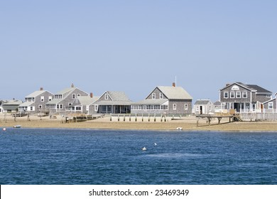 Wooden sea side houses on the beach at Cape Cod