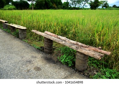 wooden seat at paddy field
