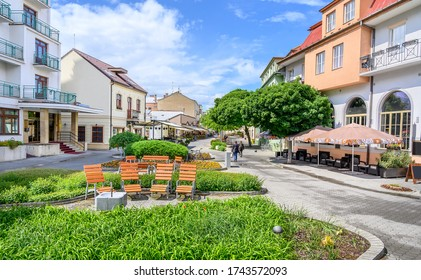 Wooden seats with a lot of green in Pedestrian zone in centre of spa town Piestany (SLOVAKIA)