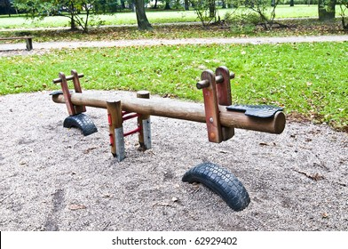 Wooden seesaw in the park, playground for kids