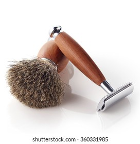 Wooden shaving razor and brush isolated on white background