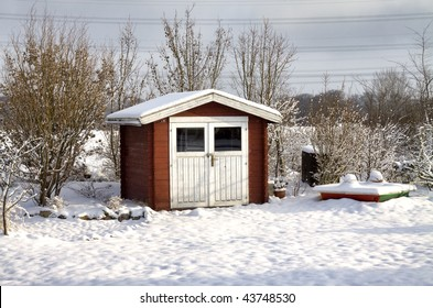 Wooden shed in winter, Germany (near Hamburg)