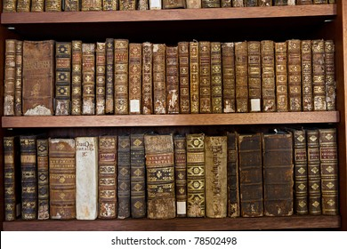 wooden shelf with historic,decorated, vintage books in Biblioteca Joanina part of university Coimbra, Portugal