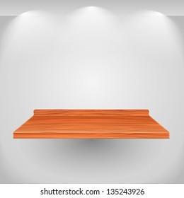 Wooden shelf on gray wall