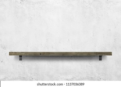 Wooden shelf over white concrete background