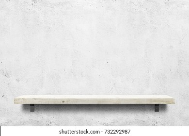 Wooden shelf over white concrete background