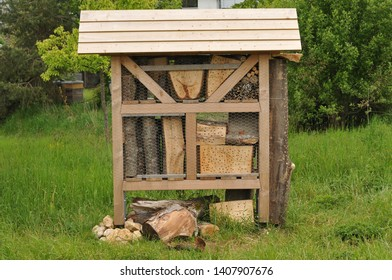 wooden shelter for solitary insects on a meadow