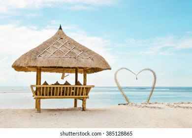 wooden shelter from the sun on the romanti�� beach in Bali. Stock image.
