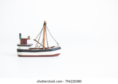 Wooden ship toy on the white background