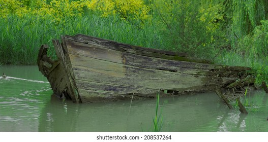 A wooden shipwreck abandoned in a river