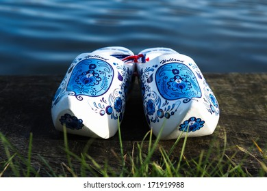 Wooden shoes along the waterside