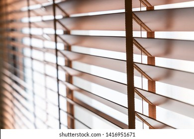 Wooden shutters blind on the window in the living room