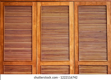 Wooden shutters, louvers. Textured background.