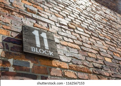 Wooden sign for block 11 on a brick wall in the former concentration camp Auschwitz, Poland