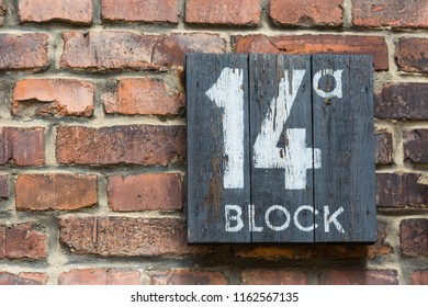 Wooden sign for block 14a on a brick wall in the former concentration camp Auschwitz, Poland