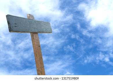 Wooden Sign with blue sky