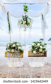 Wooden sign board decorate for Bride and Groom in Wedding Day with little flower for wedding ceremony at beach.