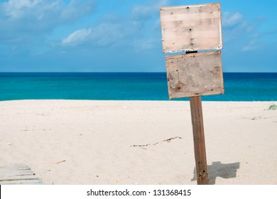 wooden sign by the sea