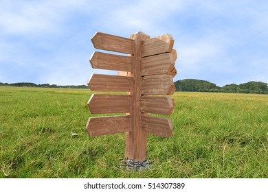 wooden sign in empty grass field