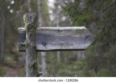A wooden sign in forest