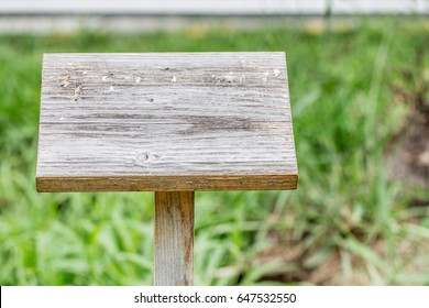 Wooden sign in grassland.Wooden board.