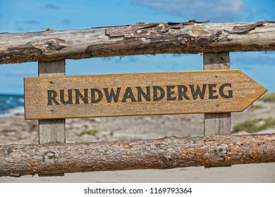 Wooden sign: hiking trail,