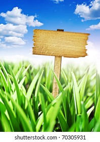 wooden sign with meadow and blue sky