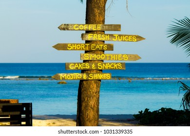Wooden sign on the beach of Hulhumale. Paradise holidays in Maldives