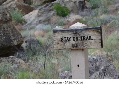 Wooden Sign on Hiking Trail