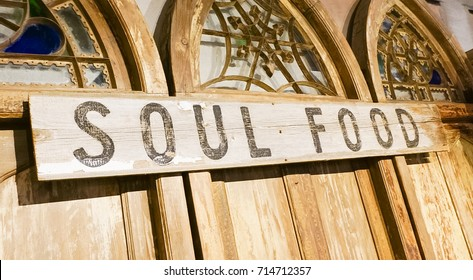 A wooden sign on ornamental doors with the words Soul Food