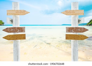 wooden sign on sand beach for outdoor advertising summer vacation concept