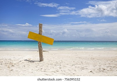 Wooden sign on tropical beach